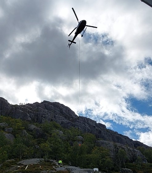 Flying helicopter in stavanger norway fjords